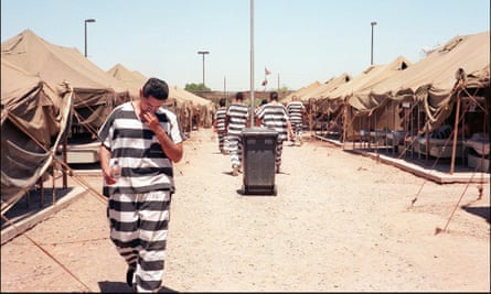 Prisoners walk under the blazing sun in Tent City, Maricopa County, 1997.