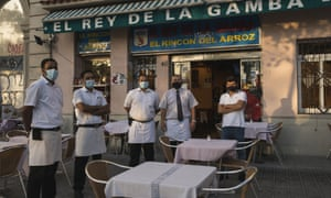 The staff of El Rey de la Gamba 2 restaurant pose for photos outside their restaurant on 27 July 2020 in Barcelona, Spain.