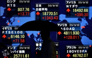 Nikkei soars 7.7 per cent on overseas rallies<br>epa04921596 Holding an umbrella, a pedestrian is silhouetted while walking past a stock markets indicator board in Tokyo, Japan, 09 September 2015. Japan's benchmark Nikkei 225 Stock Average surged 7.7 per cent, gaining more than 1,300 points, as sentiment was bolstered by overnight rallies on Wall Street and optimism on China economy. The Nikkei jumped by 1,343.43 points, or 7.71 per cent, to close at 18,770.51, its highest gain in a single day since 31 January 1994. EPA/FRANCK ROBICHON