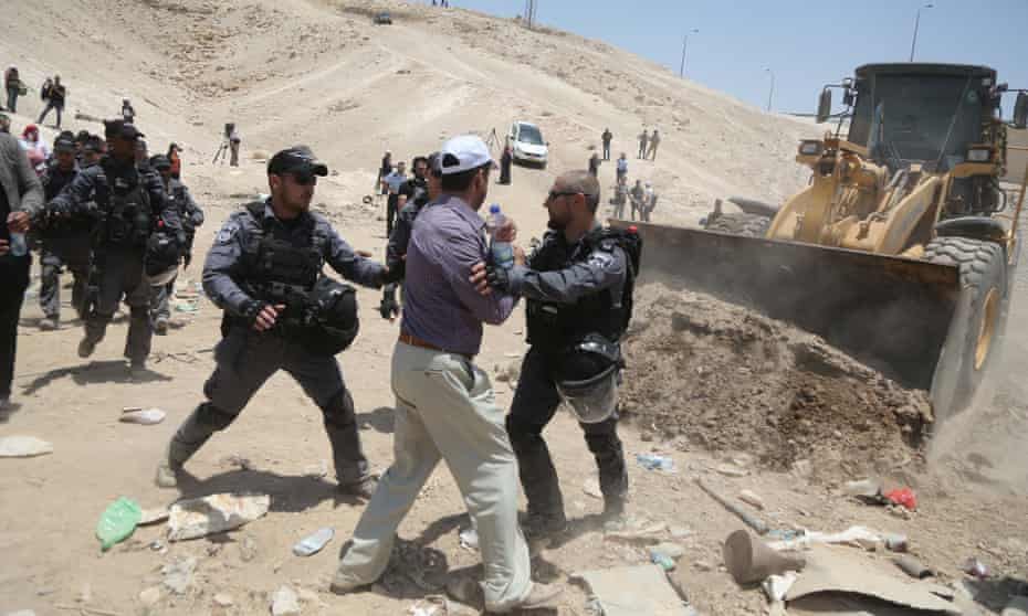 Israeli security forces intervene as Palestinians try to save their homes from demolition in Khan al-Ahmar.