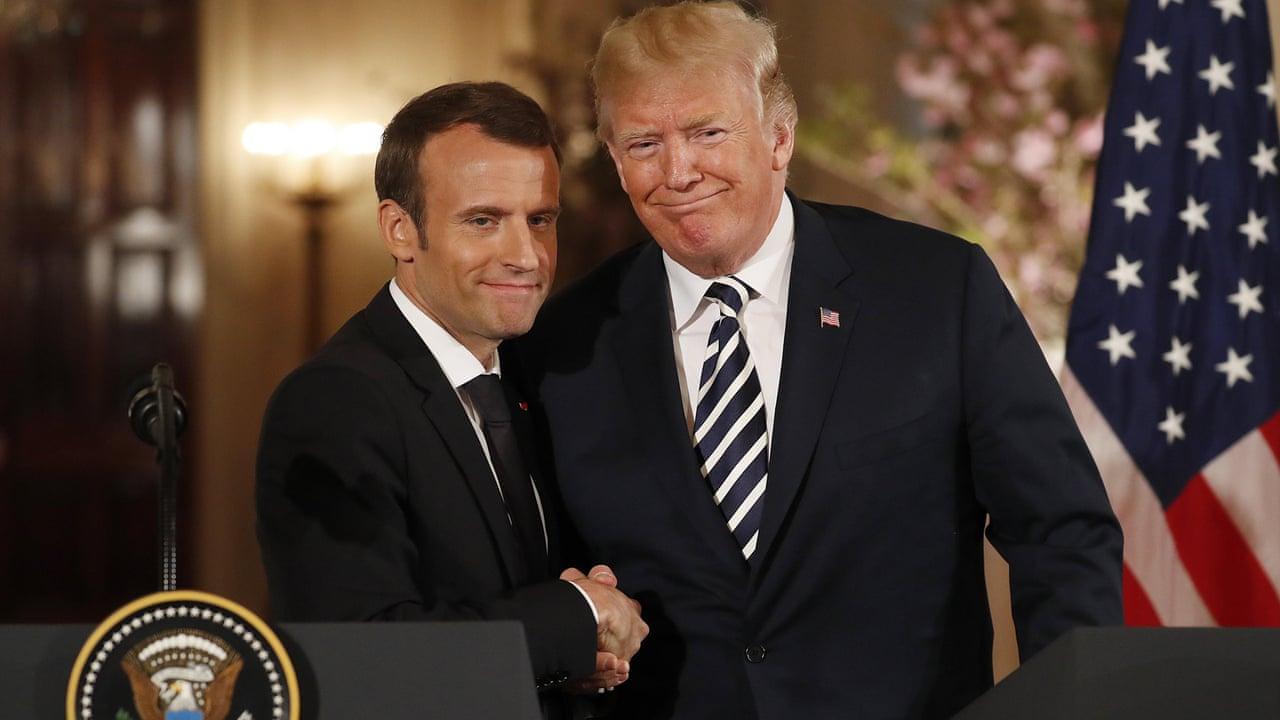 Trump And Macron Share An Awkward Handshake And A Kiss Video Us