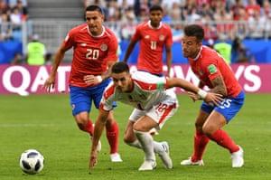 Serbia's forward Dusan Tadic beats David Guzman and Francisco Calvo to the ball as Serbia beat Costa Rica 1-0 at the Samara Arena thanks to Aleksandar Kolarov spectacular free-kick.