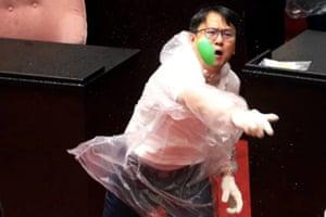 A lawmaker hurls a water balloon