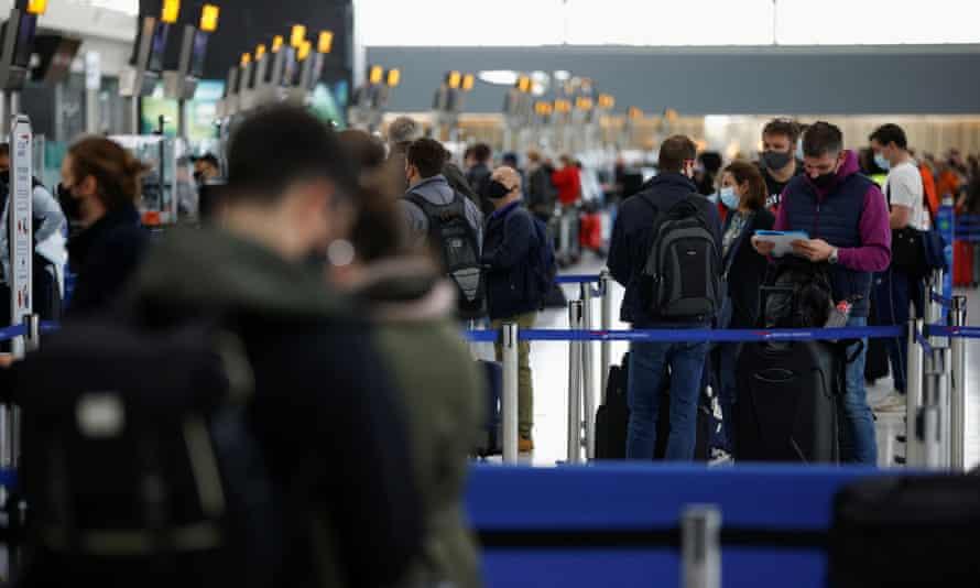 Passengers queue at Heathrow airport