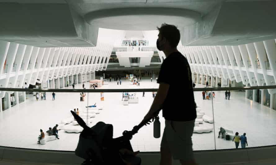 A person wears a face mask in the Oculus Mall in New York City on 29 July.