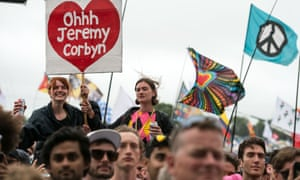 Music fans listen as Jeremy Corbyn addresses the crowd from the Pyramid Stage during Glastonbury 2017