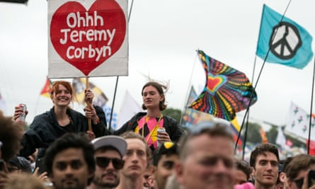 Music fans listen as Jeremy Corbyn addresses the crowd from the Pyramid Stage