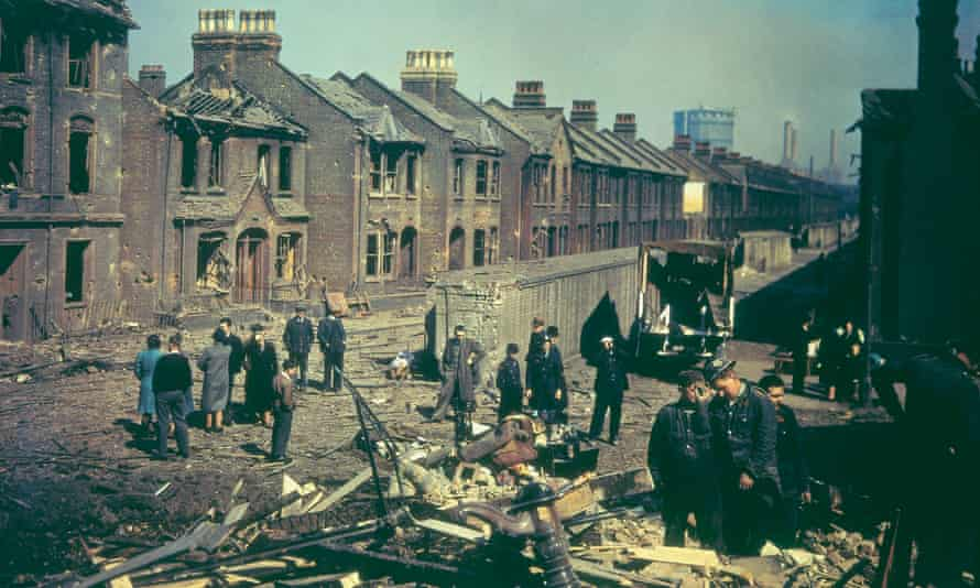 Residents inspect bomb damage to houses in London during the blitz.