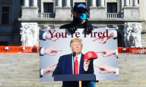 This person made their leanings very clear as they held a 'You're Fired' sign with Donald Trump's face on it, echoing his famous reality TV phrase, while describing his loss of the presidency. The man was at an Inauguration Day event in Harrisburg, Pennsylvania, on Wednesday.