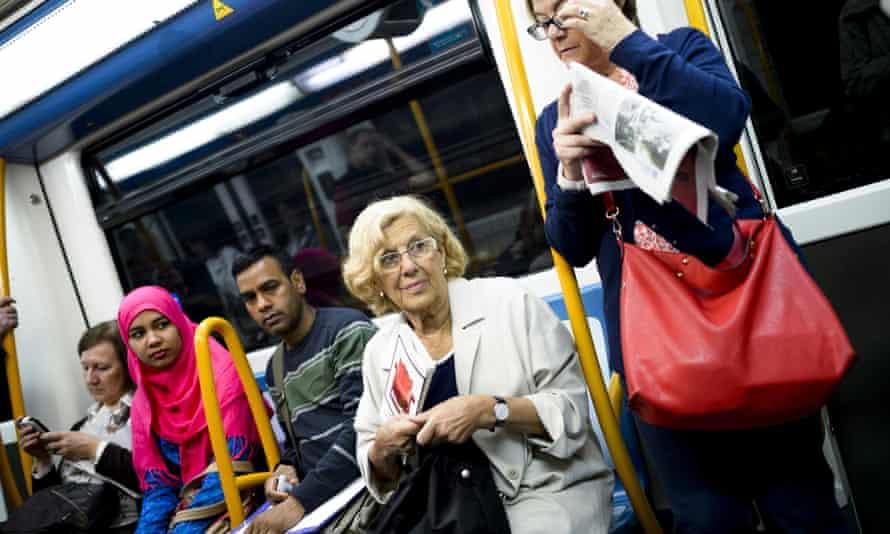 Manuela Carmena, the Podemos-backed mayor of Madrid, rides public transport to the city hall.