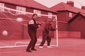 Tony Blair takes the centre ground as Alex Ferguson cowers to his left.