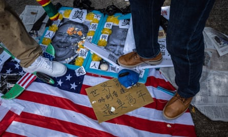 Pro-Chinese activists step on photos of US President Donald J.  Trump and US Secretary of State Mike Pompeo, outside the US Consulate in Hong Kong
