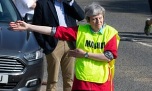 Theresa May helps as a marshal at the Maidenhead 10-mile run in Berkshire over Easter.
