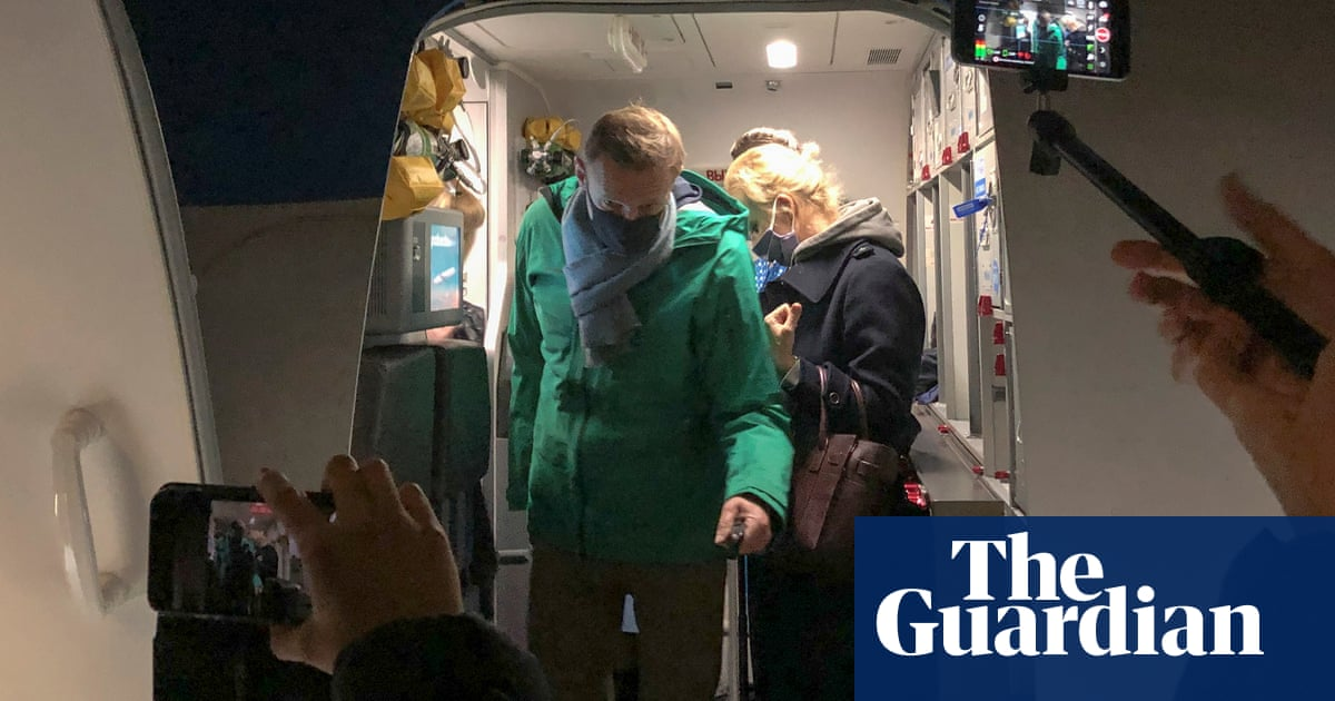 Alexei Navalny detained at airport on return to Russia