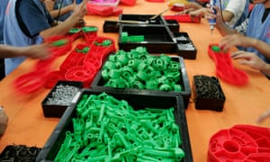 Labourers work at a toy factory in Panyu, south China's Guangdong province