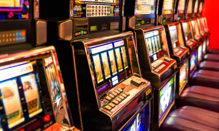 row of brightly lit poker machine