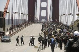 Demonstrators spanned the Golden Gate Bridge in San Francisco on Saturday.