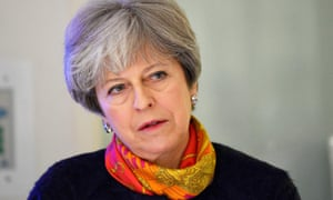 Theresa May apologised to patients whose operations were postponed for a month.
