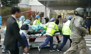 The wounded North Korean soldier is rushed to hospital after being shot while defecting to South Korea.