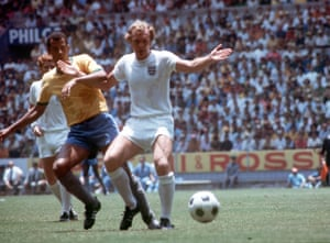 Bobby Moore shields the ball from Brazil's Carlos Alberto.