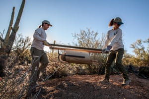 Luke Hetherington, Bioogical Engineer for Saguaro National Park, and intern Olivia Thorp, plant saguaros that were rescued from an old mineshaft that was backfillled.