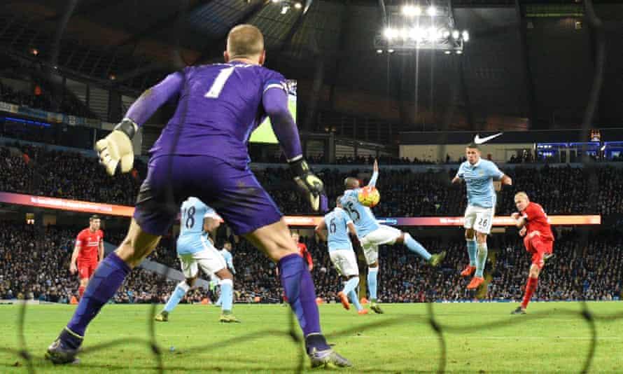 Liverpool defender Martin Skrtel fires the ball past Manchester City goalkeeper Joe Hart to make it 4-1.