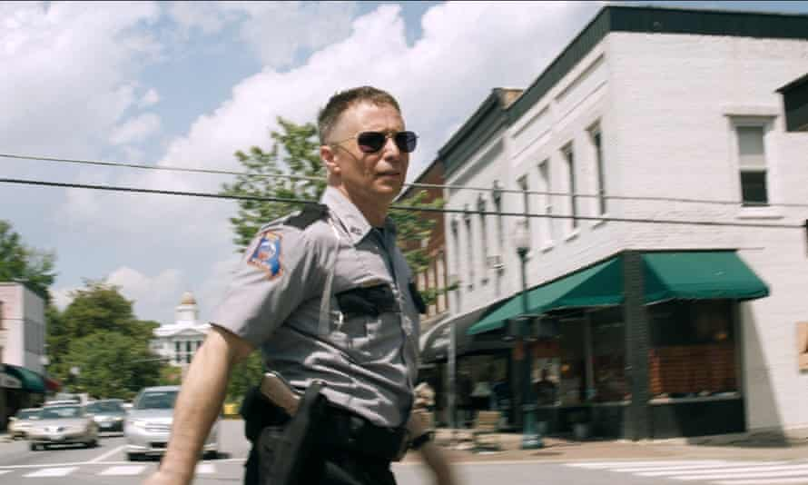 Officer Jason Dixon, played by Sam Rockwell on Main Street, Sylva, in a scene from Three Billboards.
