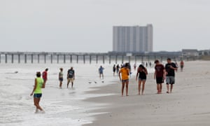 People walk on the beach ahead of the arrival of Hurricane Florence in Myrtle Beach, South Carolina Thursday.