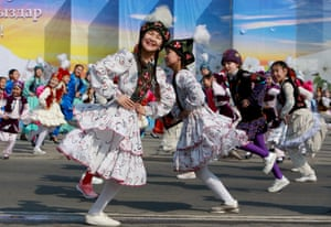 Girls dressed in national costume dance in Bishkek, Kyrgyzstan, during the celebration of Nowruz, an ancient festival marking the spring equinox