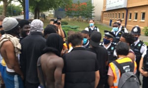 Protesters and police outside Colindale police station