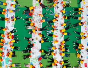Nantong, China. An aerial view of kindergarten children drawing spring-themed pictures on a canvas