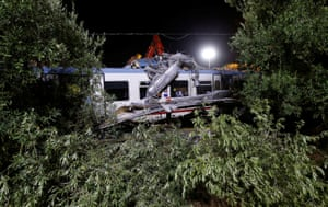 Trees frame the site where two passenger trains collided in the middle of an olive grove in the village of Corato