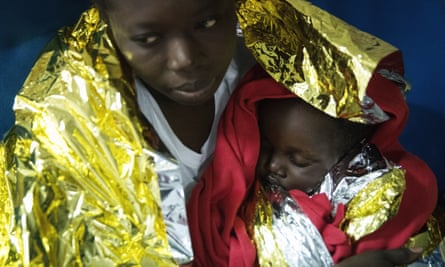 A woman and her daughter after being rescued from a wooden vessel off Italy last month.