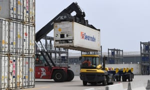 Containers are loaded on to trucks at Dover port in England