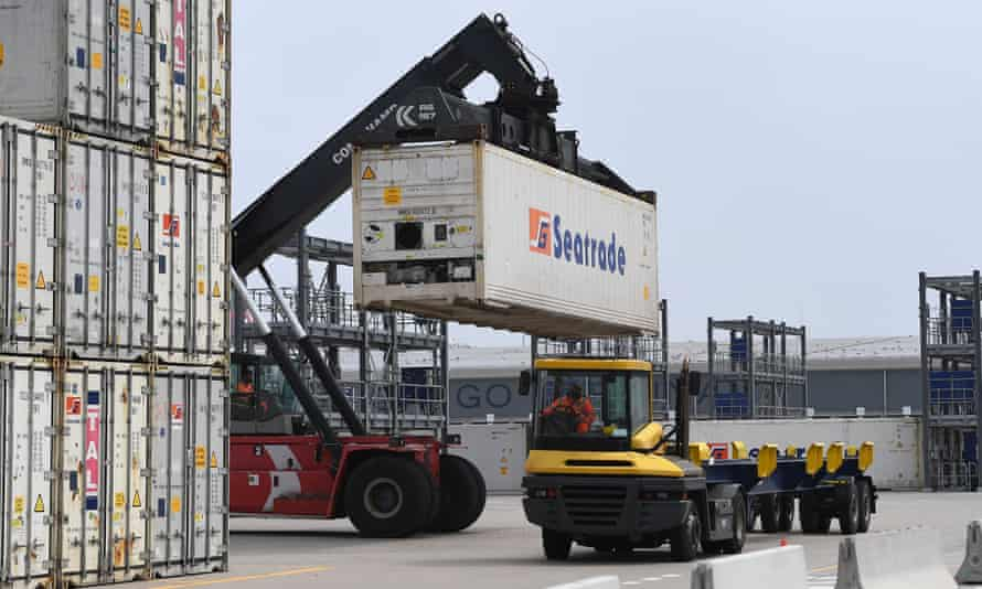 Containers are loaded on to trucks at the port of Dover