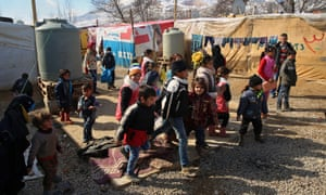 Syrian refugee children leave a makeshift school in a displacement camp in Lebanon.