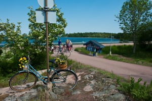 adult cyclists along a country road Aland, Mariehamn Finland