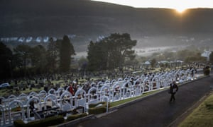 The sun rises over the valley as people arrive for a memorial service at Aberfan cemetery.