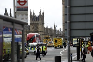 Police secure the area on the south side of Westminster Bridge close to the Houses of Parliament