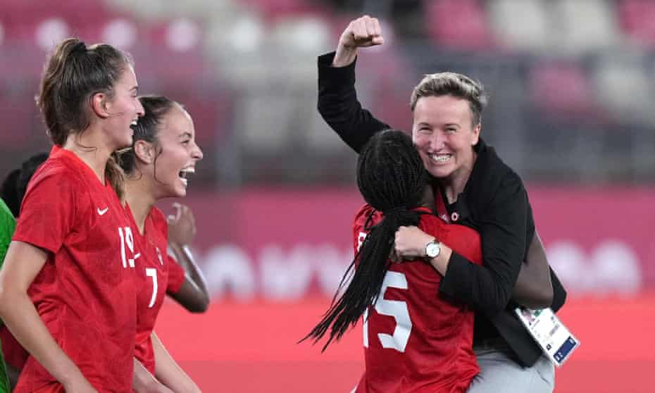 Bev Priestman celebrates with her players after Canada's defeat of the US took them into an Olympic final against Sweden.