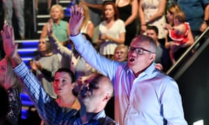 Prime Minister Scott Morrison and wife Jenny sing during an Easter Sunday service at his Horizon Church at Sutherland in Sydney, Sunday