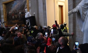 A mob breaks into the Rotunda of the US Capitol as Congress debates the certification of the electoral vote for the 2020 presidential election.
