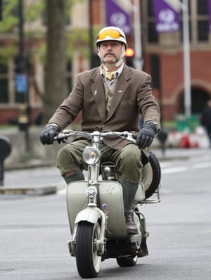 Scooter rider with yellow goggles and knickerbockers
