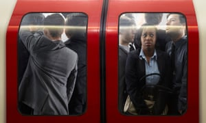 Models on busy tube train