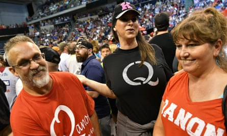 People wearing QAnon T-shirts await Donald Trump's arrival at a political rally in Wilkes-Barre, Pennsylvania, last week.