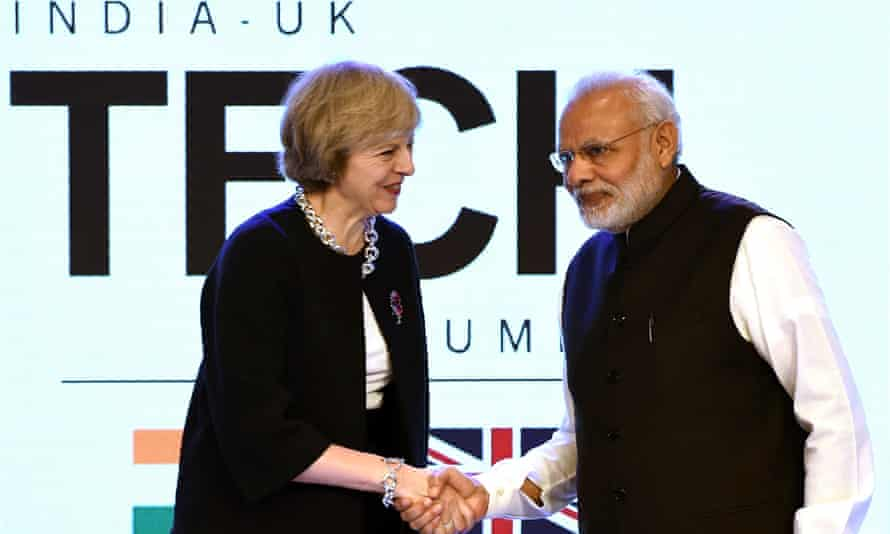 Britain's prime minister, Theresa May, shakes hands with India's prime minister, Narendra Modi, at the India-UK tech summit in New Delhi.