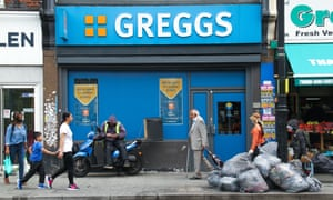 People walk past a Greggs outlet in East Ham, London