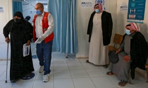 Syrian refugees wait to receive their Coronavirus vaccine, at a medical center in the Zaatari refugee camp, 80 kilometers (50 miles) north of the Jordanian capital, Amman, on February 15.