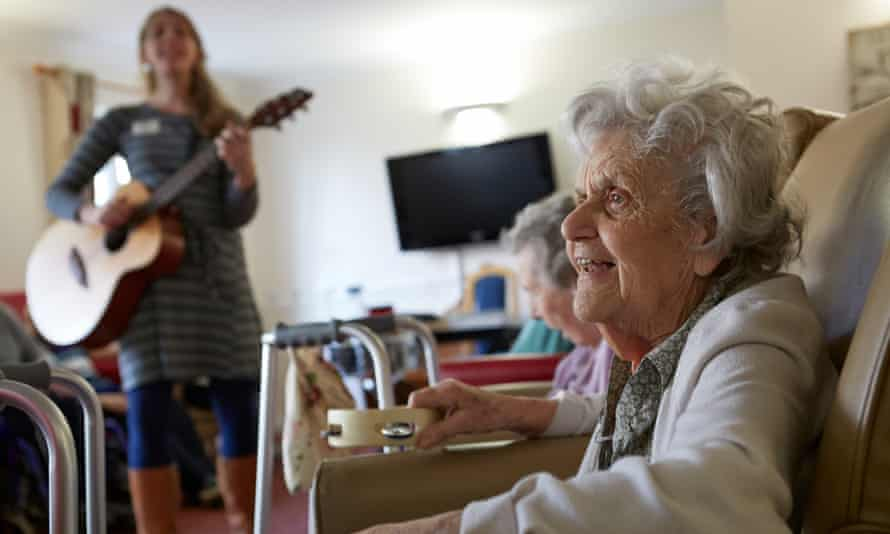 Care workers and residents join together in a music therapy session at Homestead Care Home in Oxfordshire
