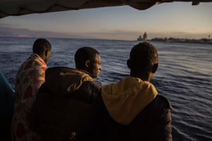 Sicily, Italy: men who were rescued off the Libyan coast look at the city of Messina from the deck of the Open Arms rescue ship as the vessel enters the port